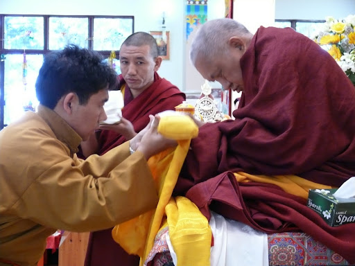Serkong Tsenshab Rinpoche offering to Lama Zopa Rinpoche during long life puja at Tushita Retreat Center, December, 2011.