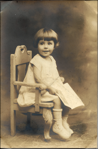 MILNE_Patricia_sitting in chair_holding paper_no frame_1926_ENH