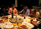 Dinner during a rainstorm with men from the city.