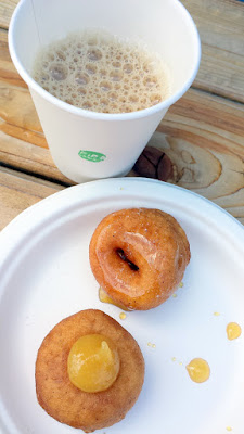 Pip's Doughnuts One each of their Raw Honey and Sea Salt doughnut and a Meyer Lemon and Pear Butter doughnut, with a sample of either their Smoky Robinson Chai or Heart of Gold Chai