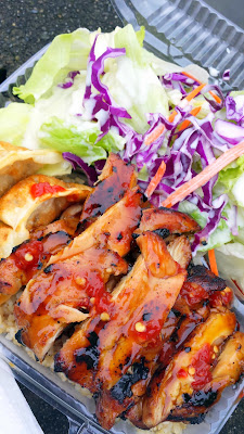 Dosirak Food Cart, specializing in Teriyaki Chicken in a lunchbox (dosirak) with salad, rice, dumplings at its location of SW 4th and College