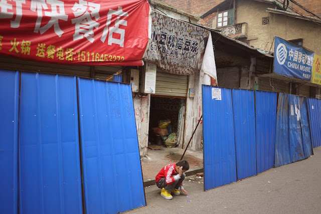 boy at Beizheng Street in Changsha, China