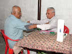 Dr.T.N.Kuppusami treating a patient :: Date: May 15, 2007, 6:28 AMNumber of Comments on Photo:0View Photo