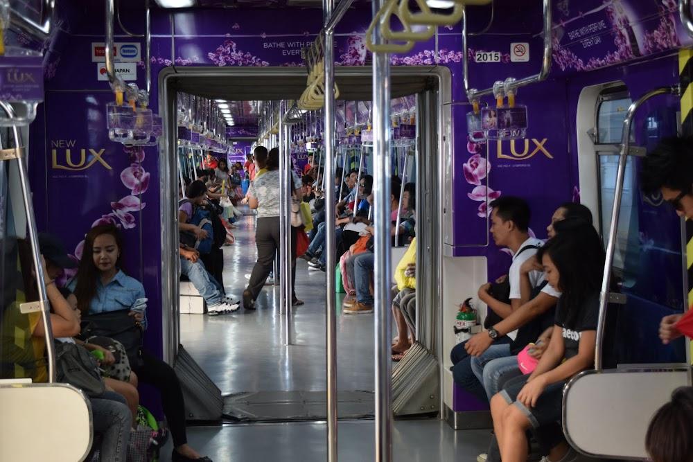 on board the LRT train in Manila