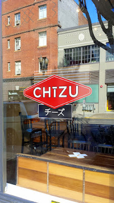 Chizu has tall bright windows that let in a lot of light into the space, and there is a 6 top right by the window, the only official table in the place when I visited. The rest are all cheese bar seats