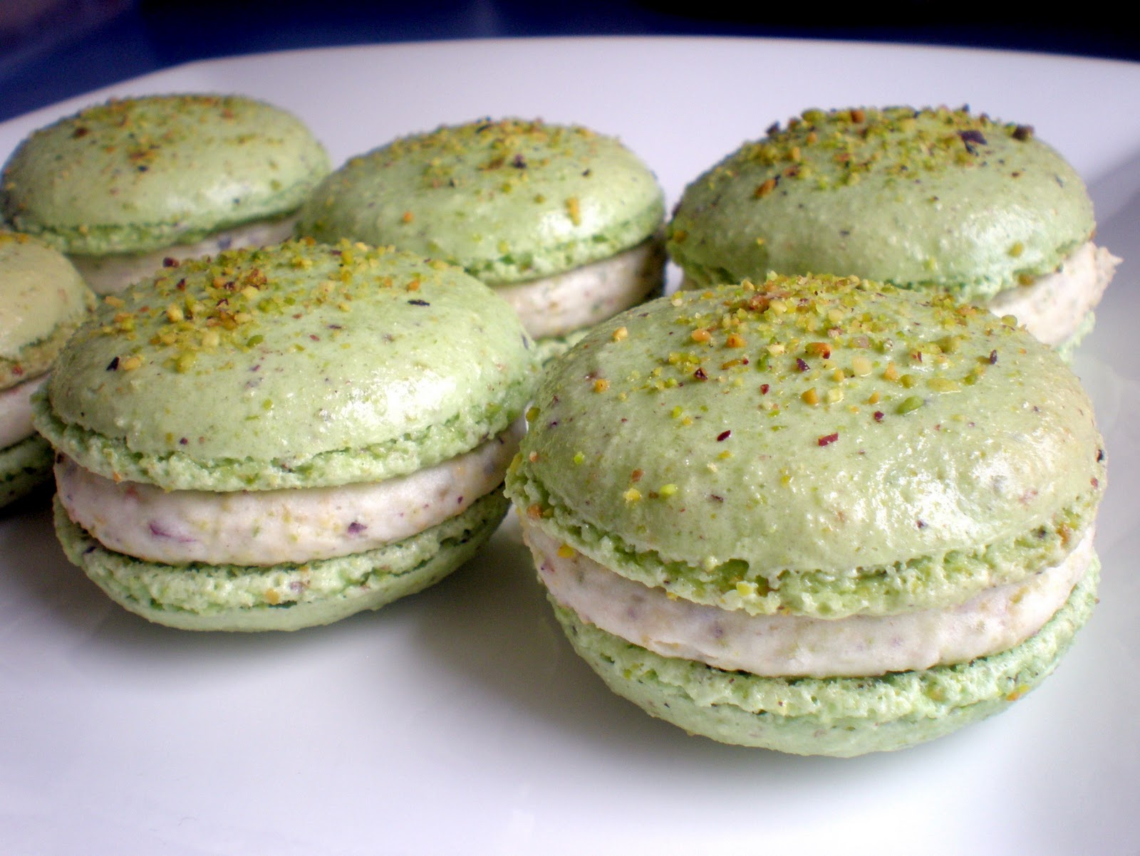 Pistachio macarons with white chocolate & pistachio buttercream.