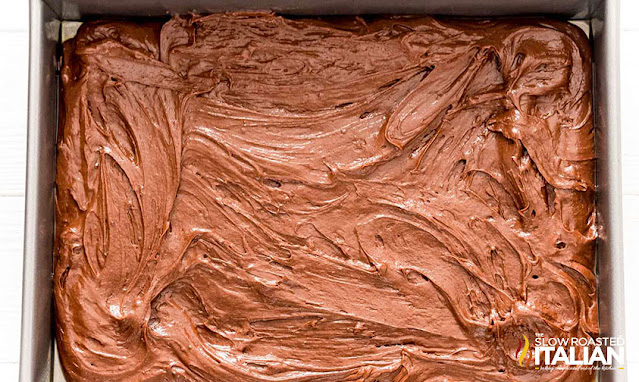 pudding poke cake batter in a pan