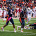 Nathan Scheelhaase #2 passes while being guarded by Donovonn Young #5 (NCAA Football: Illinois 17 vs. Indiana 31, October 27, 2012, Memorial Stadium, Champaign, IL)