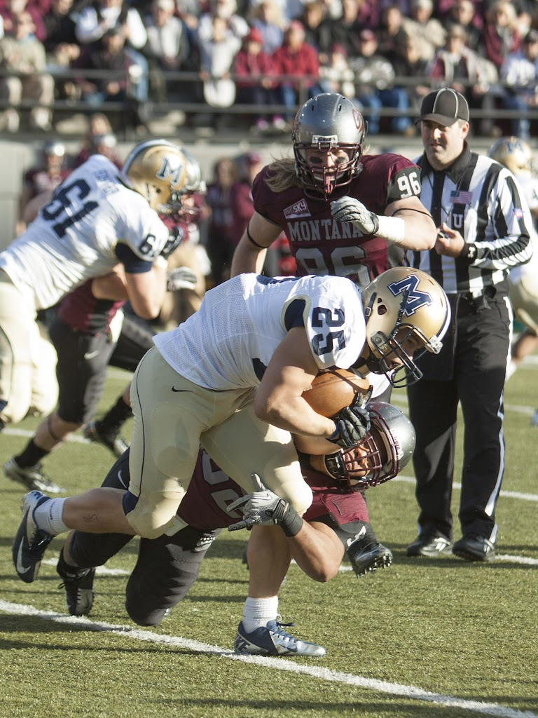 Griz linebacker John Kanongata'a tackles Bobcat running back Cody Kirk while Josh Harris (#96) pursues.  Kanongata'a ended the day with eight total tackles.  Washington-Grizzly Stadium in Missoula, Mont., November 17th, 2012.