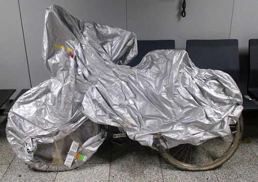 Bike wrapped in 'Goodyear Motorcycle Cover', Frankfurt Airport