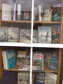 Old aircraft and war books in bookshop window