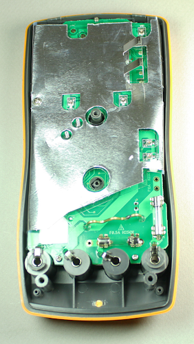 Inside the Tenma 72-7740 DMM, showing the foil shield, the two fuses, and the thick wire for high-current measurements.