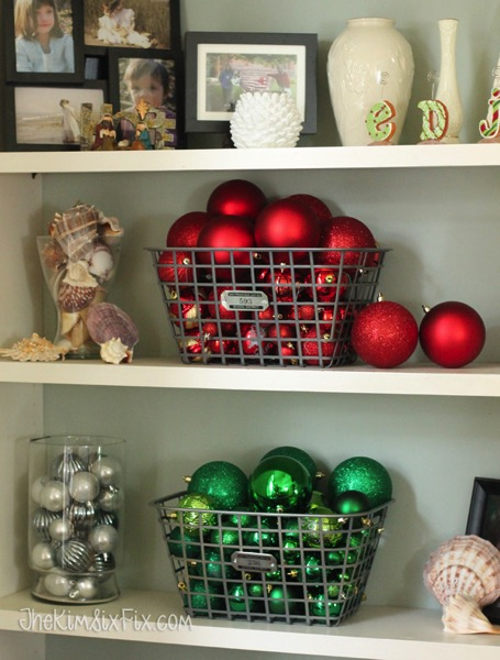 Red and green christmas balls in vintage baskets