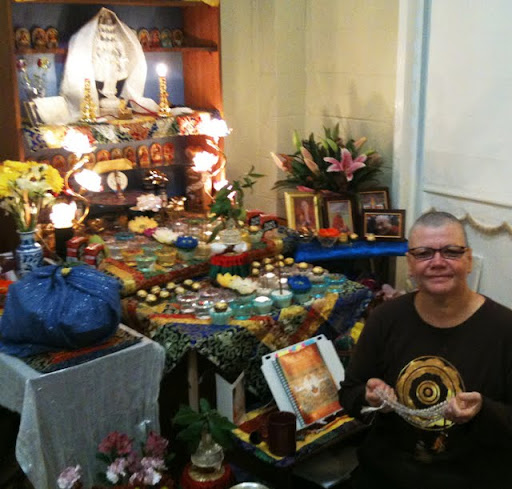 Langri Tangpa Centre's Karen Wallwork at the controls of the mothership – her amazing altar, where she did 8 solitary nyung nas, August 2011, Queensland, Australia