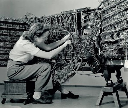 "A second photo of ""Woman wiring an early IBM computer"" by Berenice Abbott."