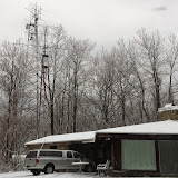 W4RX QTH, Tribander and V/UHF FM yagis @ 45 near house. Background freestanding V/UHF and microwave tower @ 120