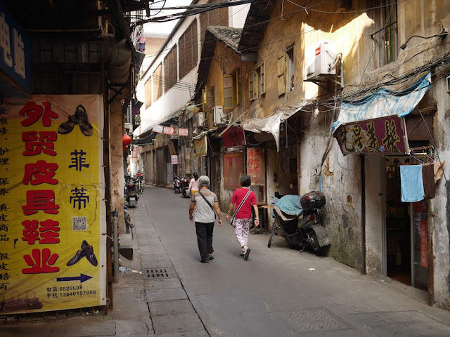 two women walking down Wuya Lane in Shaoguan, Guangdong