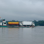 Barge transporting trucks on Napo