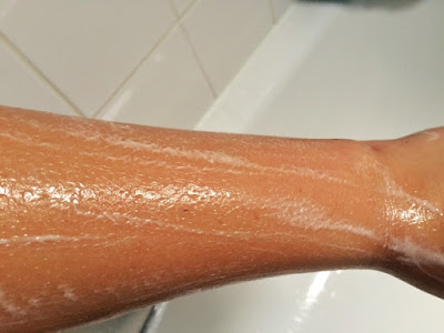 Close up of girls arm with some of Lush gold glitter #gayisok soap lathered up