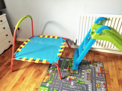 Children's trampoline and slide in room