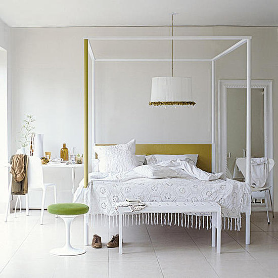 A White Four Poster Bed Looks Charming And Feminine With The Addition Of Ruffled Pendant Lamp Throw Knotted Fringe