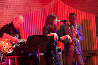 Nikki Armstrong of New Milford with Mark Brandenberg on guitar and  Rave Tesar on sax. Photos by TOM HART/  TomHartPhoto.com.