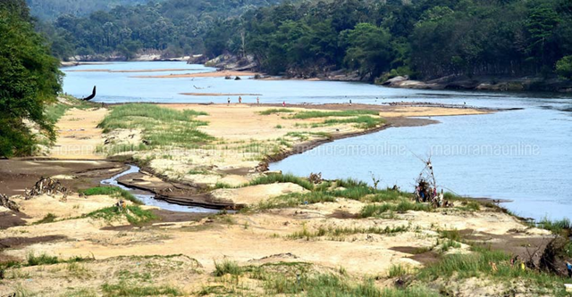 The Pamba River in India's Kerala state, which was in a spate during the days of flood in 2018, is now drying up, and its water level has decreased abnormally. This view of the river is from Vazhakkunnam, Cherukol. Photo: PTI