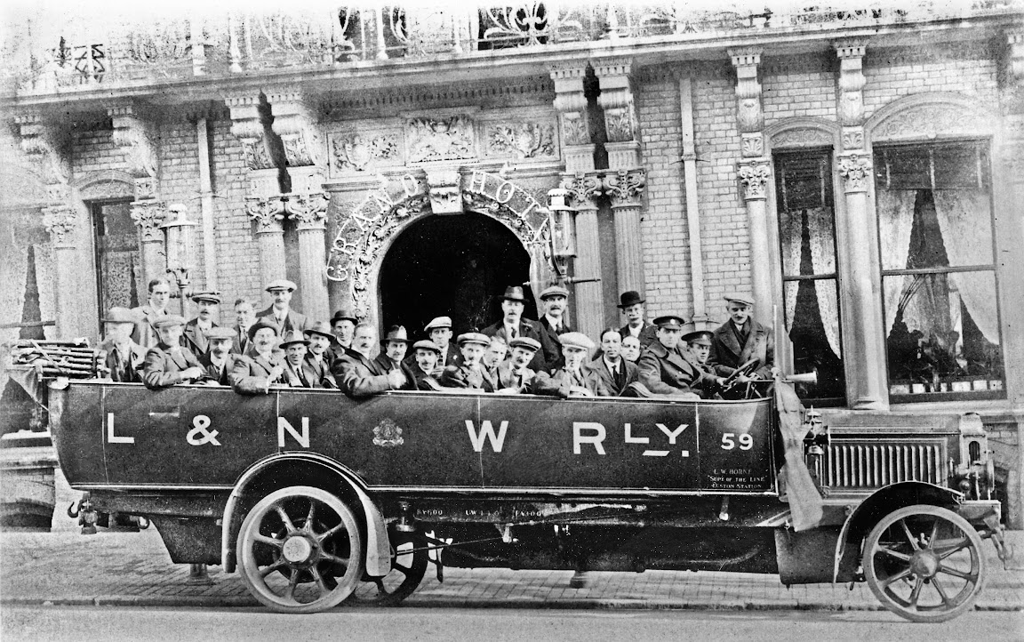 A photograph of the charabanc with the troops