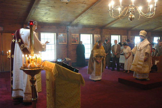 Protodeacon Michael Sochka censes the clergy.