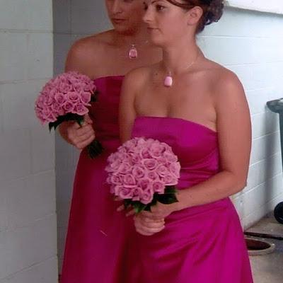 Christie's bridesmaids - Fuchia satin strapless side-drape dresses