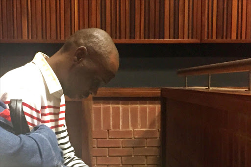 Donald Sebolai sits in the public gallery at the Johannesburg High Court, sitting in Palm Ridge. File photo.