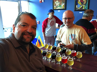 Beers arrayed between us for sampling