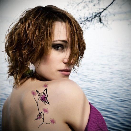 roxo_tatuagem_de_borboleta_nas_costas