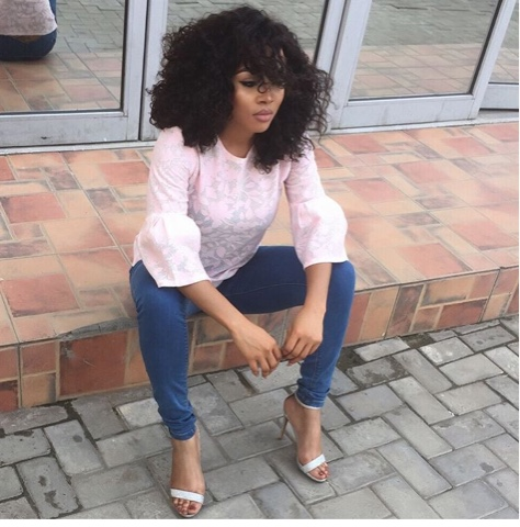 Toke Makinwa attacked for her bleached toes