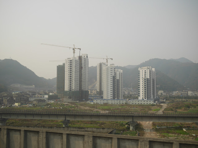 Apartment complex being built with mountain in the background in China