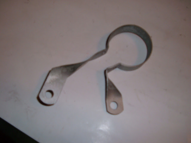 1963-1966 fuel filter bracket.. Call