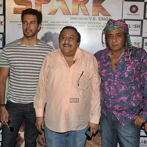 Rajneesh Duggal and Ranjeet pose with a guest during the trailer launch of Bollywood movie Spark, held at PVR in Mumbai, on July 21, 2014.(Pic: Viral Bhayani)