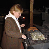 Cindy is grilling some oysters.