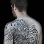 abstract phoenix back tattoo