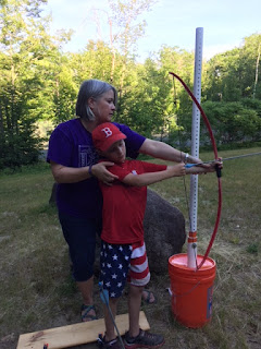 qAthlete with bow during archery lesson