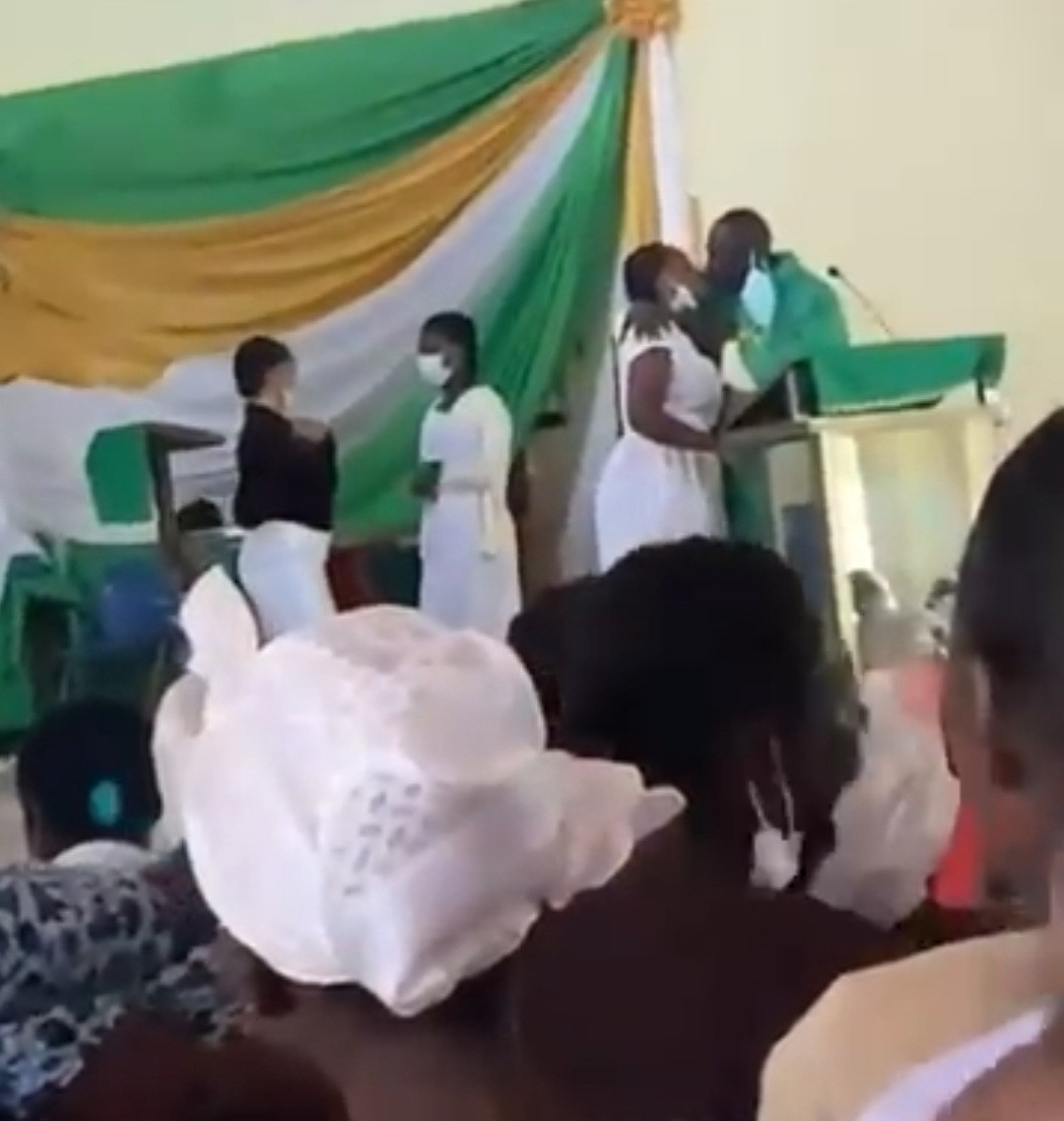 Priest filmed kissing female students on the mouth inside the church in a viral video