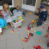 Spelen en genieten in de tuin van juf Kris