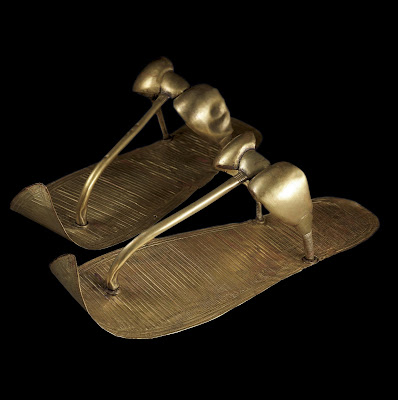 Tutankhamun's Golden Sandals - These golden sandals have engraved decoration that replicates woven reeds. Created specifically for the afterlife, they still covered the feet of Tutankhamun when Howard Carter unwrapped the mummy.