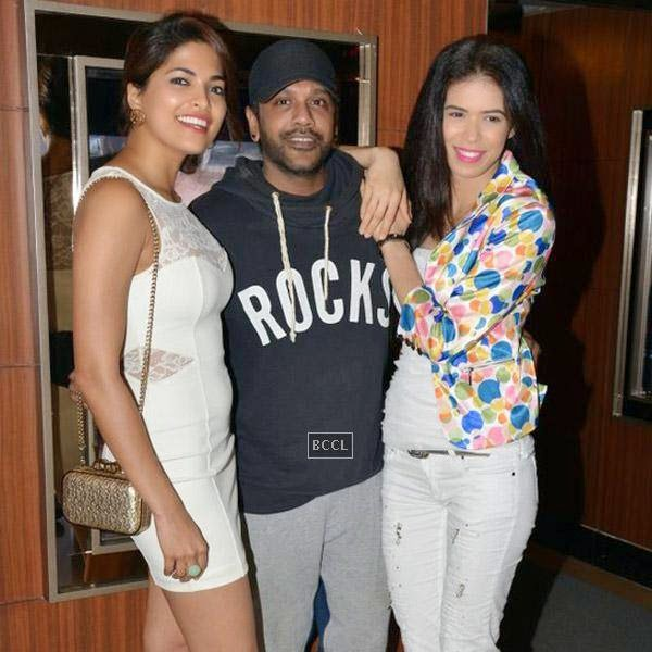 Designer Rocky S flanked by Parvathy Omanakuttan and Sucheta Sharma during the premiere of Bollywood movie Pizza, held at PVR in Mumbai, on July 21, 2014.(Pic: Viral Bhayani)