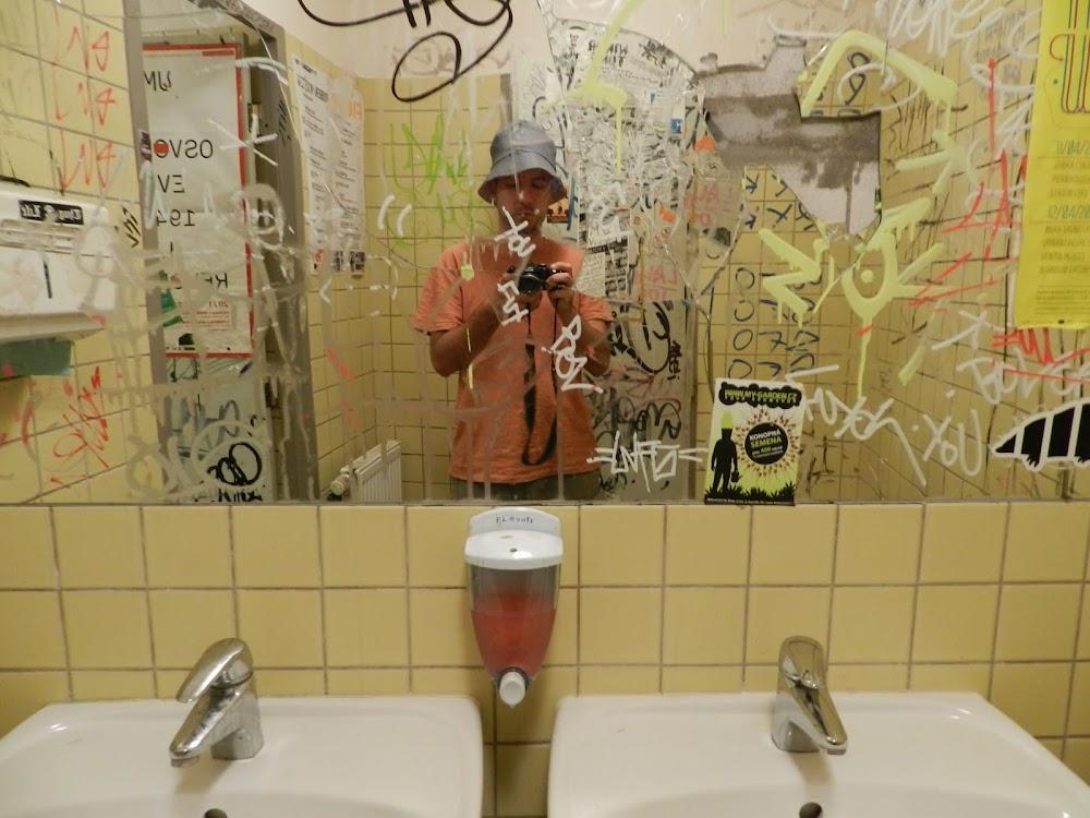 the interesting, heavily tagged bathroom... I wonder how that mirror got broken?