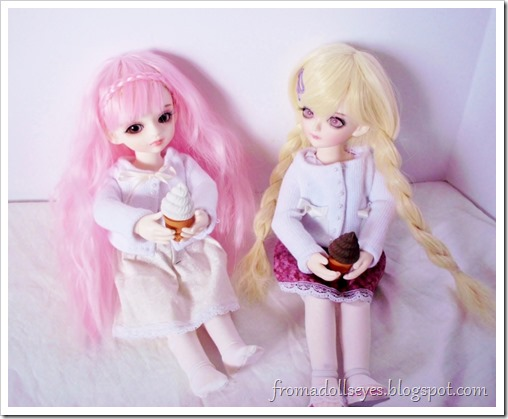 Two yosd sized ball jointed dolls enjoying ice cream cones.  They're erasers!