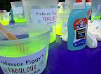 All setup for glow slime making! The glow water is made with water and highlighter ink and then mixed with glue and borax for a fun, slimey experience!