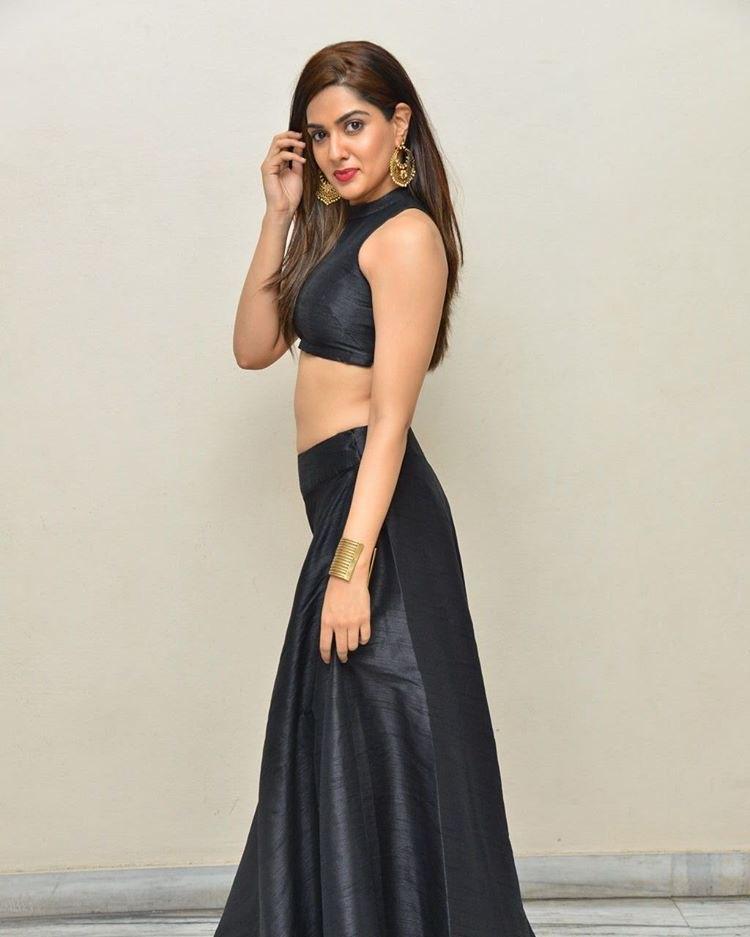 Actress Sakshi Chaudhary in black hot dress exposing navel stills from Yenti Raja YouthIlaa Undi Movie Audio Launch