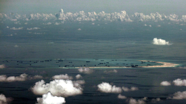 An aerial view of artificial islands built by China in disputed waters in the South China Sea, west of Palawan, Philippines, 11 May 2015. Photo: EPA / RITCHIE B. TONGO