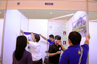 MCCID staff prepares the booth.